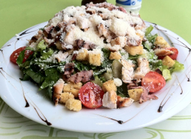 Salad with baked chicken and bacon.